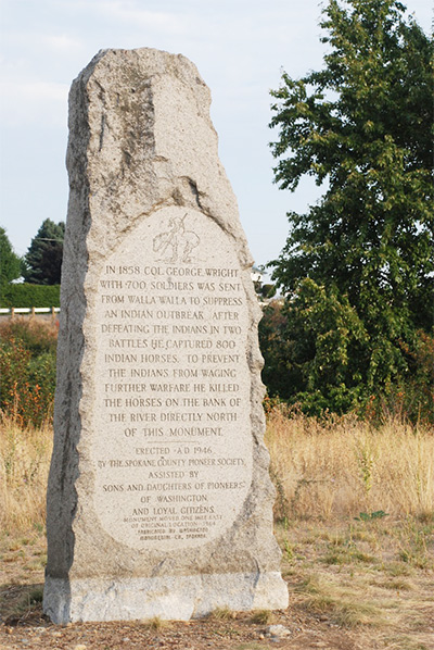 stone memorial to horses killed