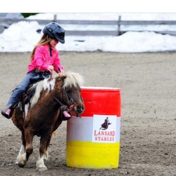 girl and pony barrel racing