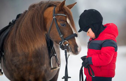 boy-with-pony-in-winter